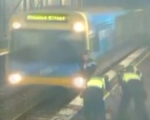 Woman narrowly avoids approaching train