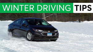 person driving a car: Essential Winter Driving Tips