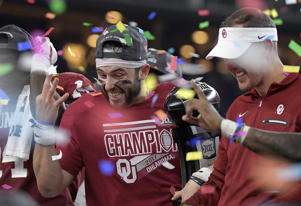Oklahoma Sooners quarterback Baker Mayfield (6) and head coach Lincoln Riley on the award platform for the Big 12 Champion trophy after the game as Oklahoma beat TCU 41-17 in the Big 12 Football Championship game at AT&T Stadium Saturday, Dec. 2, 2017 in Arlington, Texas. (Max Faulkner/Fort Worth Star-Telegram/TNS via Getty Images)