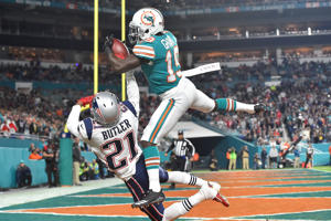 Miami Dolphins wide receiver Jakeem Grant (19) makes a catch over New England Patriots cornerback Malcolm Butler (21) for a touchdown during the second half at Hard Rock Stadium.