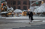 A man makes his way during a snowstorm in New York on December 9, 2017. Forecasters issued a rare winter weather warning for the southern United States, with snow hitting places that rarely see it.