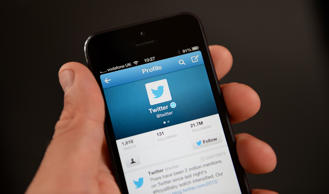 General view of the Twitter app being viewed on an iPhone.