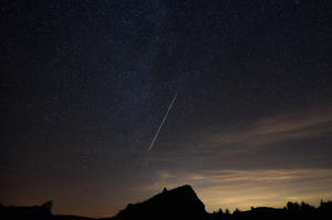 A meteor streaks across the night sky during the Geminid meteor shower over Murat Mountains in Gediz district of Kutahya, Turkey on December 14, 2017. 'Geminid' Meteor Shower or 'Shooting Stars' in public language was visible from Turkey's Kutahya province.