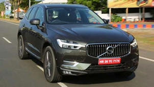 a car parked on the side of a road: Volvo XC60 Driven, It's Challengers & Answers From Siddharth Patankar