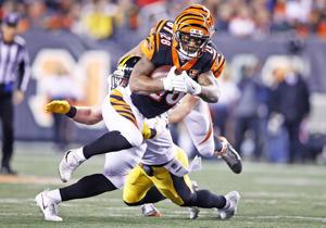 The Cincinnati running back Joe Mixon breaks a tackle from Tyler Matakevich of the Steelers on Dec. 4 in Cincinnati, Ohio. The Steelers won 23-20
