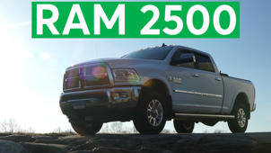 a green truck parked in front of a car: 2016 RAM 2500 Road Test