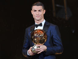 A handout photo made available by the l'Equipe Presse Office on 07 December 2017 of Real Madrid's Portuguese striker Cristiano Ronaldo posing with his trophy after receiving the 62nd Ballon d'Or award in Paris, France, 07 December 2017.