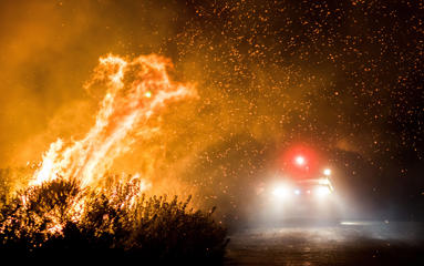 Firefighters work to extinguish the Thomas Fire as it burns past the 101 Highway towards the Pacific Coast Highway in Ventura, California, December 7, 2017.