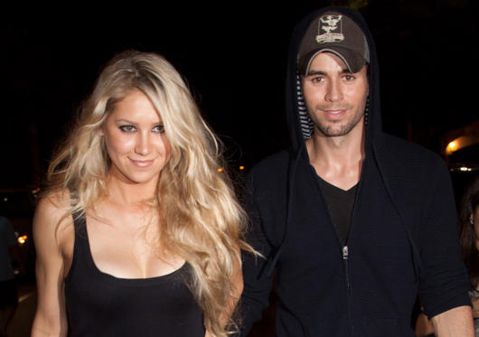 Slide 1 of 37: Anna Kournikova and Enrique Iglesias leave the Orange Carpet for the Miami Dolphins versus New York Jets game at Sun Life Stadium on September 26, 2010 in Miami, Florida.