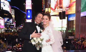 NEW YORK, NY - DECEMBER 31: Keven Undergaro (L) and Maria Menounos hold their wedding ceremony during Maria Menounos and Steve Harvey Live from Times Square at Marriott Marquis Times Square on December 31, 2017 in New York City. (Photo by Dimitrios Kambouris/Getty Images for MM)