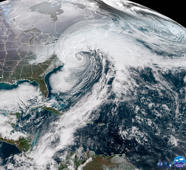 "NOAA's GOES-16 (GOES-EAst) satellite caught a dramatic view of the bomb cylcone moving up the East Coast on Jan. 4, 2017. The powerful nor'easter is battering coastal areas with heavy snow and strong winds, from Florida to Maine. Notice the long line of clouds stretching over a thousand miles south of the storm. This beast is drawing moisture all the way from deep in the Caribbean. Why is it called a ""bomb cyclone""? Meteorologists say that a storm undergoes ""bombogenesis"" when it rapidly intensifies over a short period. More precisely, it's a mid-latitude cyclone that sees its central pressure drop 24 millibars or more within 24 hours. Storms like this typically bring heavy precipitation, strong winds, and coastal storm surge and are common along the East Coast during the winter months."