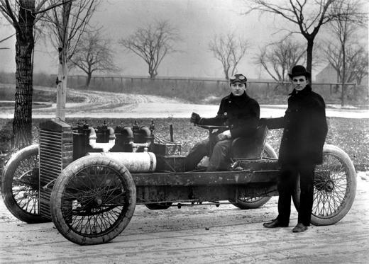 Slide 1 of 11: Henry Ford stands beside the Ford 999 racer constructed in Oct. 1902, his first contribution to automobile racing.  The race car driver is Barney Oldfield.  The location is not known.