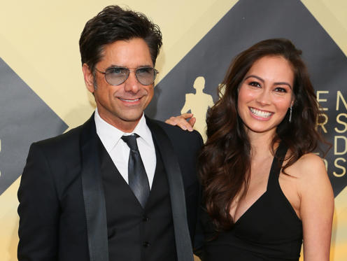 Slide 1 of 50: John Stamos and Caitlin McHugh arrive for the 24th Annual Screen Actors Guild Awards at the Shrine Exposition Center on January 21, 2018, in Los Angeles, California. / AFP PHOTO / Jean-Baptiste LACROIX (Photo credit should read JEAN-BAPTISTE LACROIX/AFP/Getty Images)