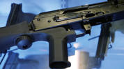 A device called a 'bump stock' is attached to a semiautomatic rifle.