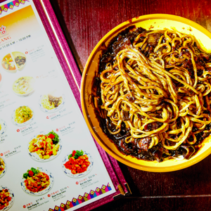 a close up of food on a table: Jajangmyeon