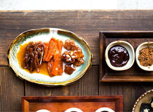 "a plate of food on a wooden table: Behind the ""Jang"" in Gochujang"