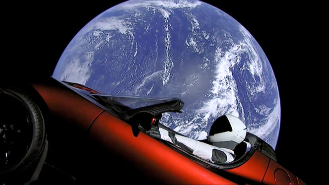 Slide 1 de 40: CAPTION: This image from video provided by SpaceX shows the company's spacesuit in Elon Musk's red Tesla sports car which was launched into space during the first test flight of the Falcon Heavy rocket on Tuesday, Feb. 6, 2018. (SpaceX via AP)
