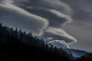 Lenticular and cumulus clouds form along the eastern mountain range on Jan. 25, 2018, in South Lake Tahoe, Calif. Though a six-year drought in California and Nevada was called off last year following record rain and up to 25 feet of snow in the Sierra Nevada Mountain Range, this year's snowfall levels compared to last have been dismal.