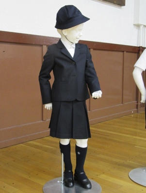 This undated photo provided by Taimei Elementary School shows new school uniform designed by Italian brand Armani.