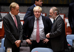 Boris Johnson, UK foreign secretary (C) speaks to Sir Tim Barrow (R) during a Security Council Meeting September 21, 2016 on the situation in Syria at the United Nations in New York