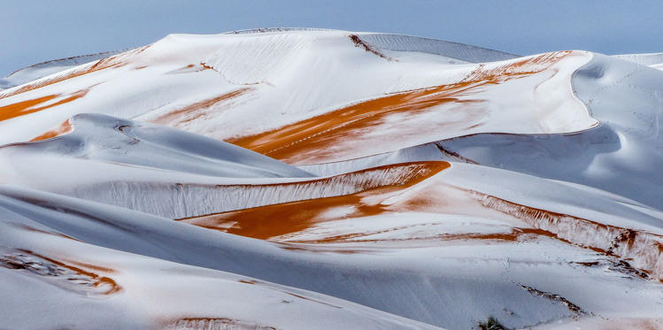 Slide 1 of 32: Snow in the Sahara Desert near the town of Ain Sefra, Algeria