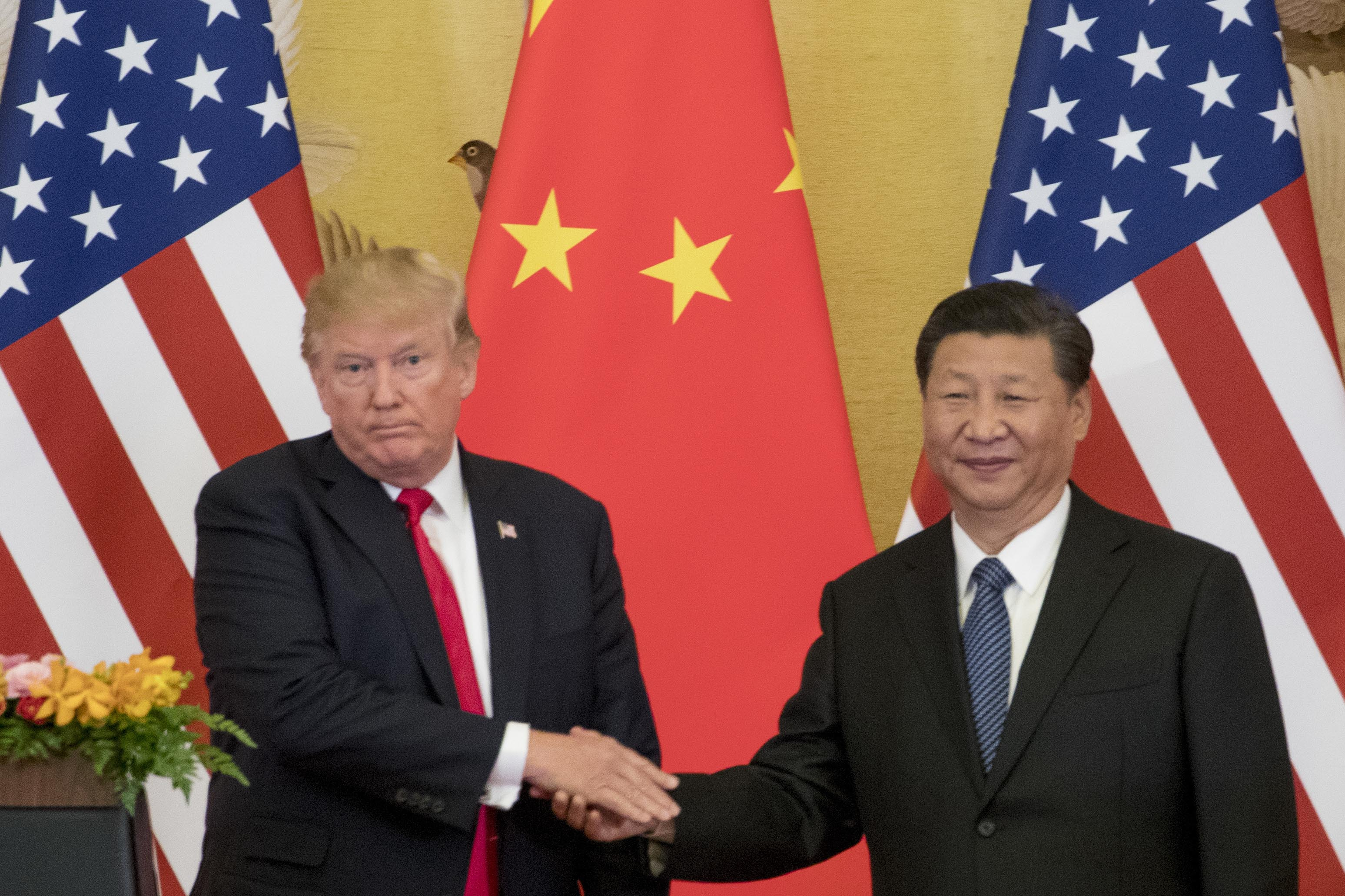 Trump signs HK bills, China warns retaliation