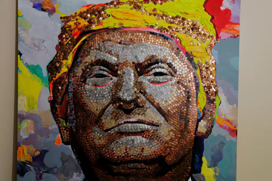 Slide 2 of 27: A portrait of U.S. President Donald Trump made of coins and casino tokens by artists Daria Marchenko and Daniel D. Green is displayed in a classroom in New York, U.S., January 31, 2018.