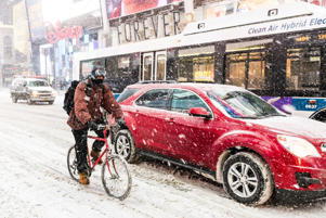 A person seen cycling during heavy snow storm