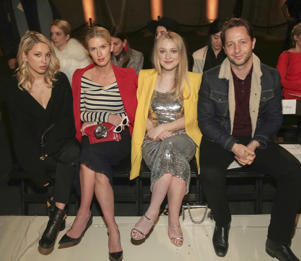 Princess Maria-Olympia of Greece and Denmark, from left, businesswoman Nicky Hilton Rothschild, actress Dakota Fanning and writer Derek Blasberg attend the Oscar De La Renta 2018 Fall/Winter Runway Show during New York Fashion Week at the Cunard Building on Monday, Feb. 12, 2018 in New York. (Photo by Brent N. Clarke/Invision/AP)