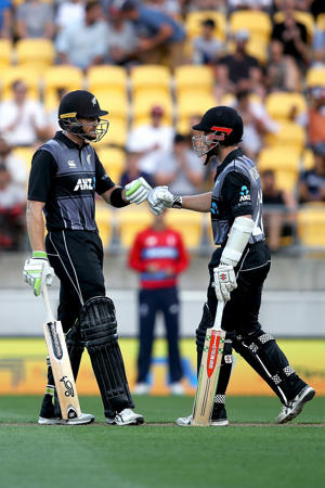 Martin Guptill (L) and Kane Williamson (R) of the Blackcaps during the International Twenty20 match between New Zealand and England at Westpac Stadium on February 13, 2018 in Wellington, New Zealand.