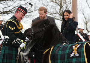 Prince Harry and Meghan Markle meet Pony Major Mark Wilkinson and regimental mascot Cruachan IV during a walkabout on the esplanade at Edinburgh Castle, during their visit to Scotland