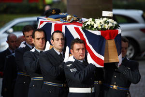 The coffin of Flight Lieutenant Sean Cunningham is carried into Coventry Cathedral prior to his funeral.