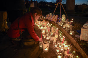 People take part in a candlelight vigil in the Prince Albert Gardens in Swanage, Dorset to pay their respects to 19 year old Gaia Pope whose body was found nearby on November 18