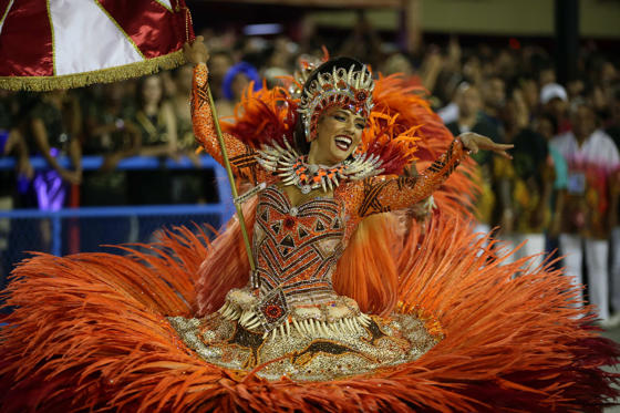 Slide 1 of 48: A member of the Grupo Especial Salgueiro samba school takes part in the carnival celebration at the Marques de Sapucai sambodrome in Rio de Janeiro, Brazil, 13 February 2018. The Carnival in Rio de Janeiro runs from 09 February to 18 February and is one of the largest carnivals in the world.