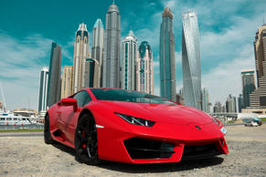 Dubai, United Arab Emirates -  May 8, 2017. Red Lamborghini Huracan in Dubai Marina; Shutterstock ID 752797450