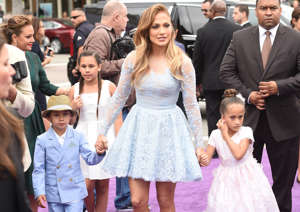 CAPTION: WESTWOOD, CA - MARCH 22: Recording Artist/actress Jennifer Lopez (C) and son Maximilian David Muniz (L) and daughter Emme Maribel Muniz (R) arrive at Twentieth Century Fox And Dreamworks Animation's 'Home' Premiere at Regency Village Theatre on March 22, 2015 in Westwood, California. (Photo by Jason Merritt/Getty Images)