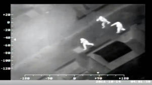 Still from Greater Manchester Police handout footage of Scott Moore (left) being pursued by two police officers, as the rugby player has been jailed at Bolton Crown Court after pleading guilty to dangerous driving and three counts of assault.