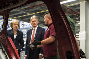 Theresa May and Philip Hammond at the Jaguar Land Rover factory on September 1, 2016 in Solihull, England