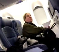 Woman who threatened flight attendant in viral video suspended from job