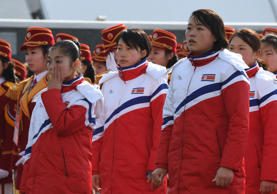 North Korean figure skater Ryom Tae Ok, left, wipes her tears away as she sings the national anthem during a welcoming ceremony for the team at the Olympic Village in Gangneung on February 8 ahead of the Pyeongchang 2018 Winter Olympic Games.
