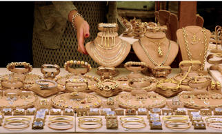 FLORENCE, ITALY - OCTOBER 30, 2015: A shopkeeper arranges jewelry in the window of her shop on the landmark Ponte Vecchio bridge in Florence, Italy. Gold jewelry merchants have operated shops on the Medieval bridge over the Arno River for centuries. (Photo by Robert Alexander/Getty Images)