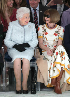 Queen Elizabeth II sits next to Anna Wintour (right) as they view Richard Quinn's runway show before presenting him with the inaugural Queen Elizabeth II Award for British Design as she visits London Fashion Week's BFC Show Space in central London.