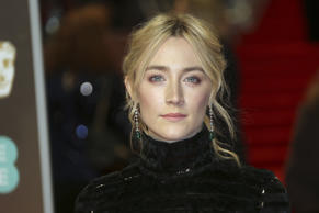 Actress Saoirse Ronan poses for photographers upon arrival at the BAFTA 2018 Awards in London, Sunday, Feb. 18, 2018. (Photo by Joel C Ryan/Invision/AP)