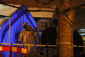 Investigators next to a police tent outside the Mill pub at the Maltings in Salisbury near to where former Russian double agent Sergei Skripal was found critically ill by exposure to an unknown substance.