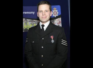 "This undated handout photo provided by Wiltshire Police on Thursday, March 8, 2018 shows Detective Sergeant Nick Bailey. Whoever attacked  Sergei Skripal, a former Russian spy, with a rare nerve agent is guilty of a ""brazen and reckless act,"" and Britain will respond without hesitation when it becomes clear who is responsible, the country's security minister said Thursday. Skripal and his daughter are in critical but stable condition at a hospital in Salisbury. A police officer who came to their aid is in a serious condition, though he is conscious and talking, Rudd said. He was identified Thursday as Sgt. Nick Bailey. (Wiltshire Police via AP)"