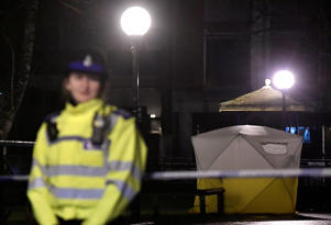 Police officers stand guard beside a cordoned-off area, after former Russian military intelligence officer Sergei Skripal, who was convicted in 2006 of spying for Britain, became critically ill after exposure to an unidentified substance, in Salisbury, southern England, March 5, 2018.