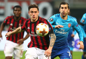 AC Milan's Davide Calabria in action with Arsenal's Henrikh Mkhitaryan