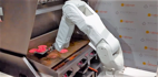 Burger-flipping robot takes a break after just a day at work