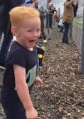 Little boy gets thrill of a lifetime during motorcycle race