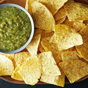 a dish is filled with food: Cooked Green Salsa (Salsa Verde)